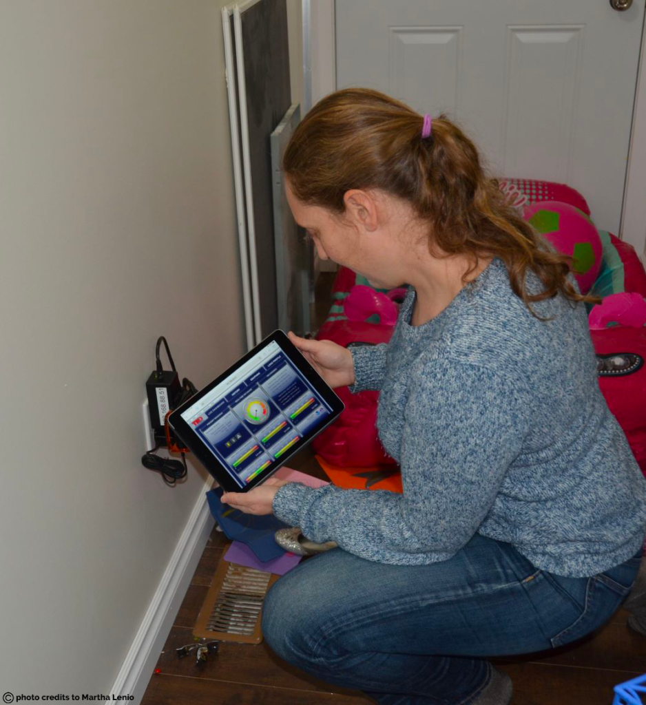 Martha testing a Home Energy Monitor in Gjoa Haven as part of a pilot project.